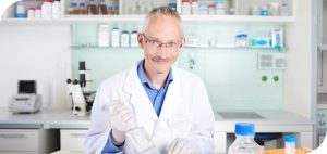 scientific expert with a multipipette developing customized stable assay cell lines with constitutive target expression